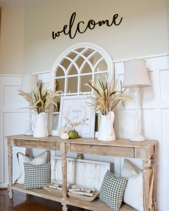 light wooden console table, white vases, pillows, white table lamp, white decoration, mirror
