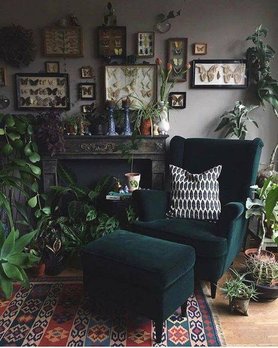 living room corner with yellow floor, rug, green chair with ottoman, fireplace with plants