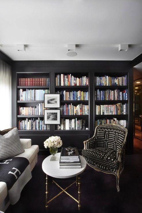 living room dark floor, black bookcases, white sofa, black chair, white coffee table