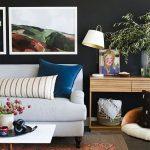 Living Room Grey Floor, Orange Rug, White Sofa, White Coffee Table, Wooden Cabinet, Black Wall