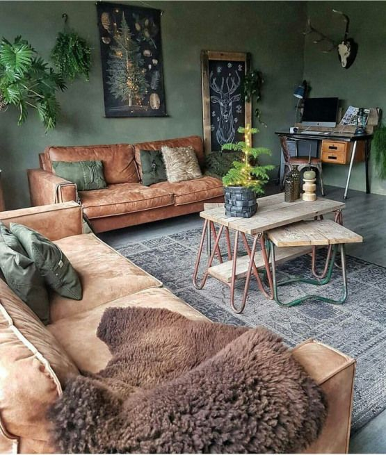living room, grey floor, rug, wooden coffee tables, brown sofas, pillows, green wall, wall decorations, plants, study table