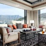 Living Room, Tribal Pattern Rug, White Sofa, Black Coffee Table, White Ceiling, White Curtain, Black Round Side Table