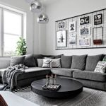 Living Room White Floor, Grey Rug, White Wall, Wire Board, Silver Pendants, Black Low Round Coffee Table