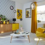Living Room, White Wooden Floor, White Wall, Yellow Rattan Chair, Wooden Cabinet With Yellow Drawers, White Coffe Table, Yellow Curtain, Silver Pendant