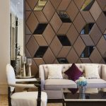 Living Room With Brown Rug, White Chair, Off White Sofa, Square Coffee Table, Side Table, Geometric Pattern Textured Wall