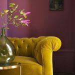 Living Room With Dark Floor, Rug, Pink Walls, Mustard Sofa