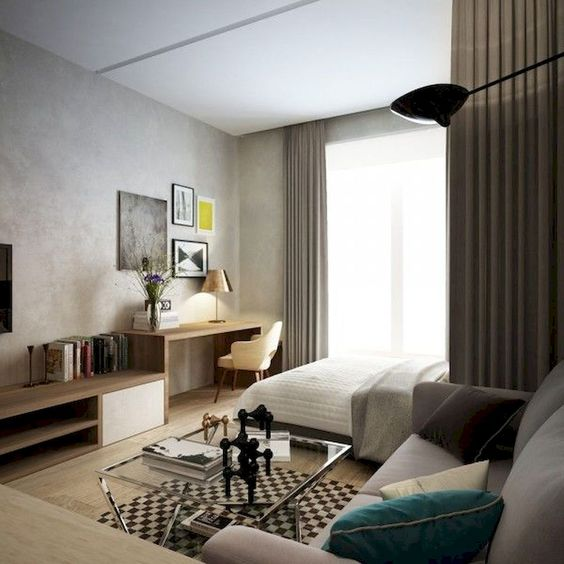 living room with rug, study area in the corner, wooden cabinet, grey sofa, bedding, curtains