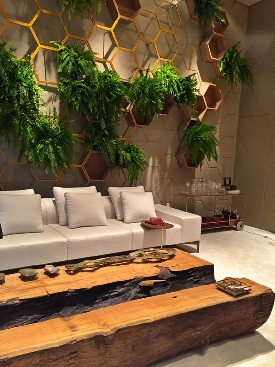 living room with white marble floor, long wooden table, white sofa, hexagon shelves for plants on the wall