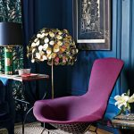 Living Room With Wooden Floor, Brown Rug, Blue Chair, Purple Chair, Blue Wall, Side Table, Blue Cover Table Lamp, Green Curtain, Round Side Table