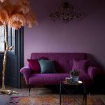 Living Room With Wooden Floor, Rug, Purple Sofa, Purple Wall