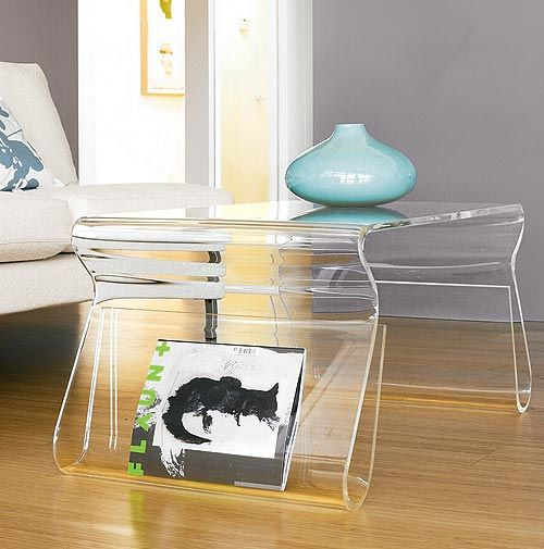 living room with wooden floor, white sofa, acrylic coffee table with curve on its legs