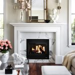 Living Room With Wooden Floor, White Wall, White Marble Around Fireplace, White Sofa, Faux Zebra Print Rug, Glass Table, Mirror, Sconces