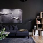 Living Room Wooden Floor, Black Rug, Black Wall, Dark Purple Sofa, Wooden Boxes For Books, Coffee Table