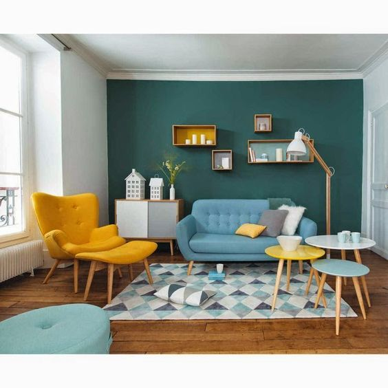 living room, wooden floor, blue sofa, yellow lounge chair with ottoman, blue white rug, blue white yellow round coffee table, green wall, white wall, white floor lamp, shelves, cabinet