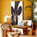 Living Room, Wooden Floor, Rug, White Lounge Sofa With Tribal Patterns, Brown Chairs, Yellow Wall, Plants, Wooden Side Table