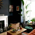 Living Room Wooden Floor, Wooden Coffee Table, Black Wall, White Fireplace, Orange Sofa, Orange Ottoman, Pot With High Plant, Green Moss Cushion For Reading Nook