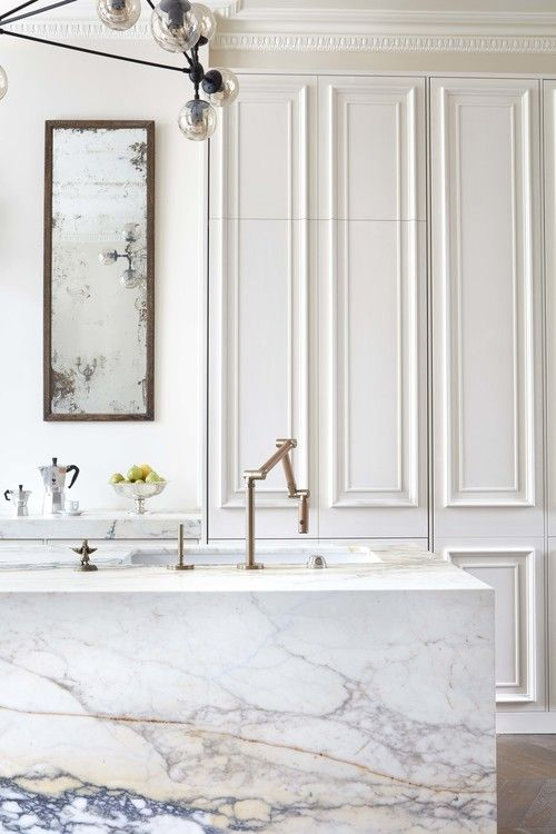 marble countertop, island with marble cover, golden faucet