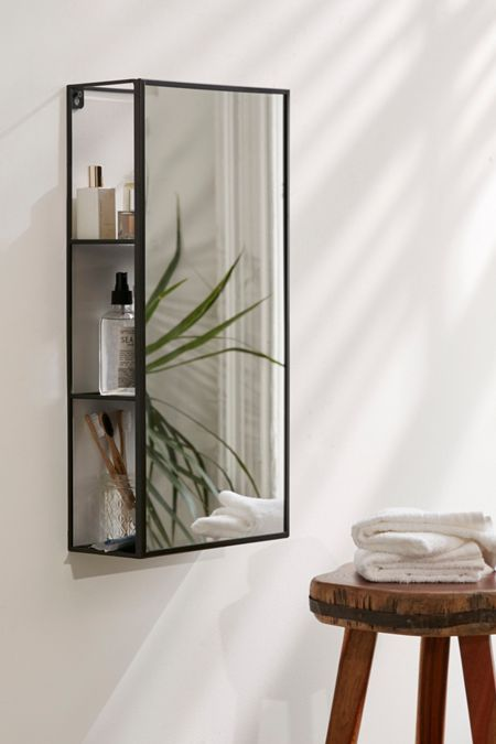 mirror with thin frame, shelves behind