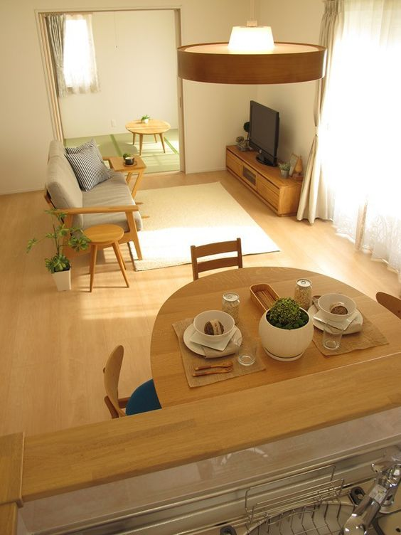 open room with wooden floor, tatami at the bedroom, wooden tables, wooden chairs, wooden sofa with grey cushion, wooden cabinet, wood covered pendant