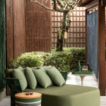 Outdoor Chair In Green With Pillows In Green, Round Side Table In Green