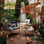 Patio With White Lounge Chair And Rattan Chair With Grey Cushion