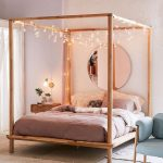 Pink Bed With Wooden Bedstead With Canopy Posts, Fairy Lights As Canopy