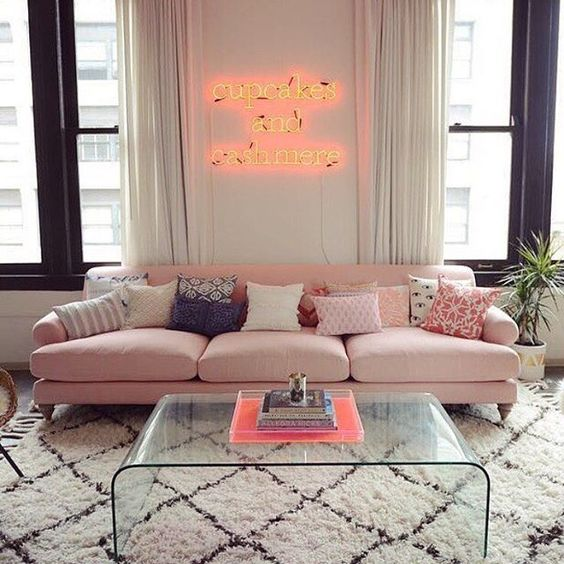 pink sofa with big fluffy cushion, lay back back, round low arm rest