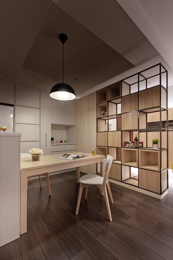 room divider of built in bookshelves with boxes randomly put