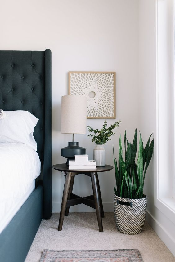 round basic bedside table with four feet