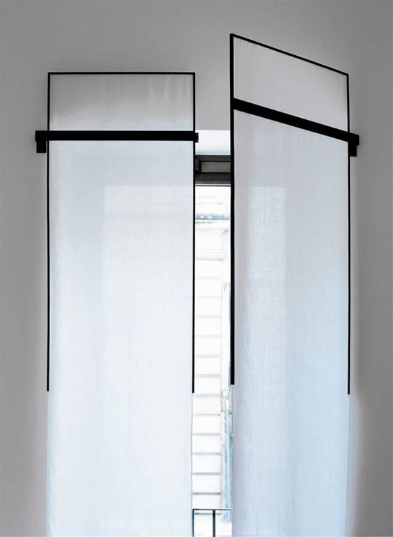 see through white long shutters with black frames