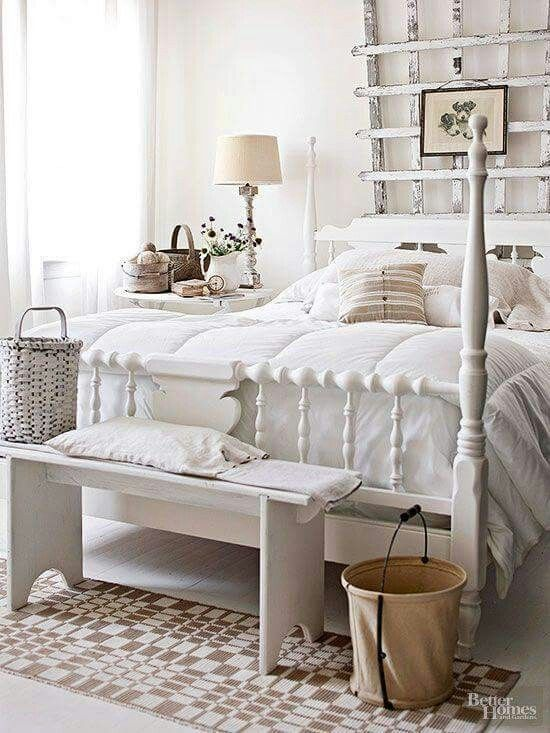 short wooden bench on bed end