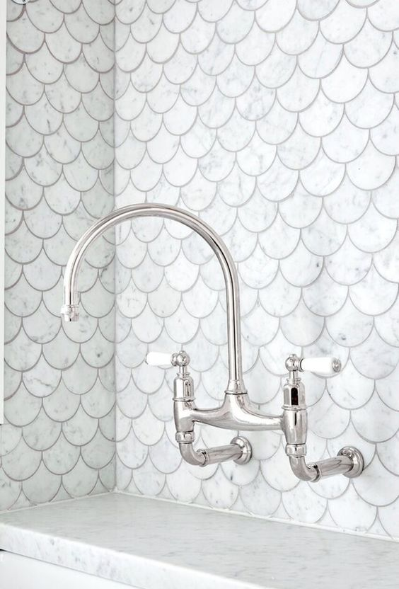 sink with white marble, silver faucet, whitefish scales wall