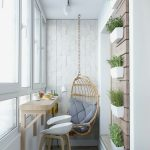 Small Balcony With Wooden Floor, Textured Wall, Plants On The Wall, Bar Table On The Wall With Stool And Swinging Chair
