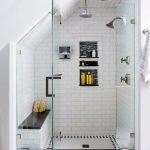 Small Bathroom, White Tiny Tiles On Floor, White Subway Wall Tiles And Walls, Dented Shelves, Built In Bench In White Subway Tiles