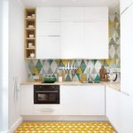 Small Kitchen With White Cabinet Under And On Top Brown Tiles Kitchen Top, Colorful Backsplash, Yellow Patterned Tiles