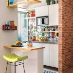Small Kitchen With Whtie Cabinet, Colorful Backsplash, Window, Bar With Wooden Top, Green Cushioned Bar Stool, Shelves