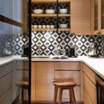 Small Kitchen With Wooden Cabinet, White Kitchen Top, Sink, Black And White Backsplash, Wooden Stool