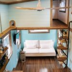 Small Loft, Glossy Wooden Floor, Kitchen With Yellow Top, White Sofa, Bedroom Floor, Shelves, Stairs