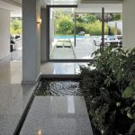 Small Poind Inside A Terrace With Grey Marble, Glass Window