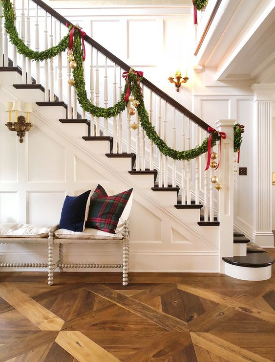 stairs with dark rail, dark polished stairs, green garlands hung from the hold