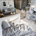 Studio Apartment With Wooden Floor, Grey Sofa, Rug, Bed, Study Area, Kitchen, Round Dining Table