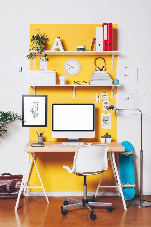study area with yellow paint on the area, shelves, table, computer, chair, white painted wall surrounding