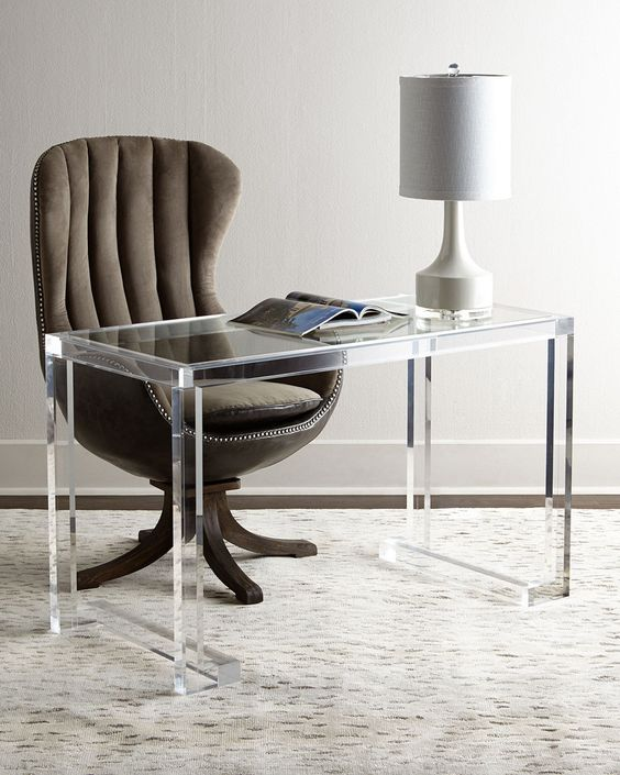 study room with white floor, acrylic table, curvy chair, white table lamp