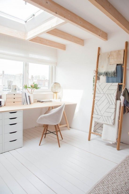 study room with white wall, white wooden floor, white chair, brown table with white cabinet, in fron of the window
