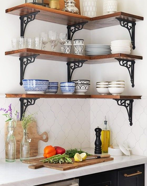 three corner wooden open shelving with accented metal support on the wall