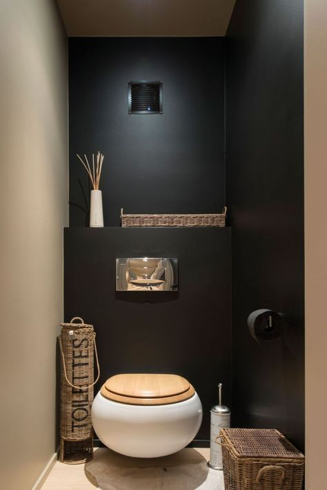 toilet with round white bowl, brown wooden lid, hidden cistern, flush push button