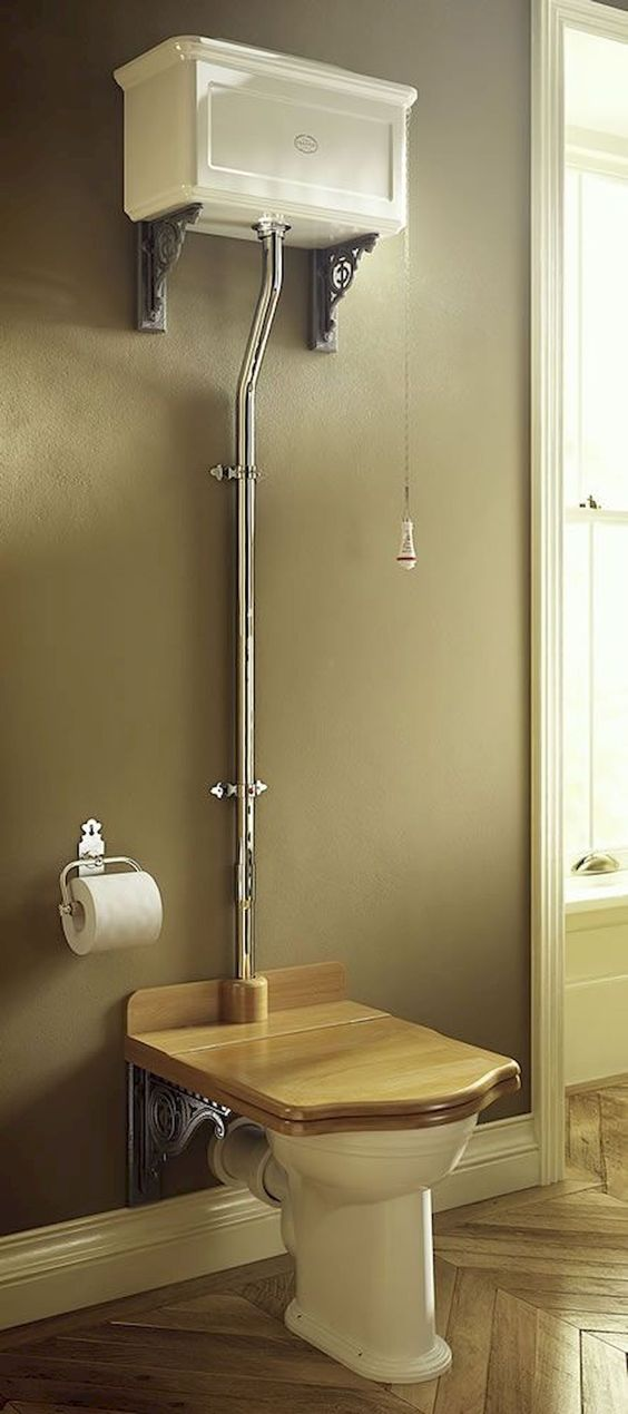 toilet with white bowl, wooden square shaped bidet, white cistern far above the toilet, metal pipe, hanging flush switch