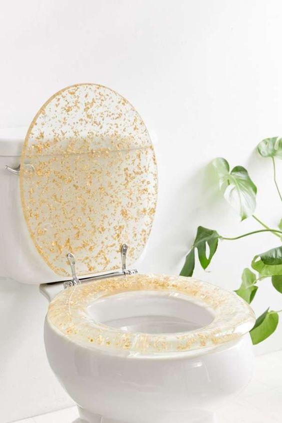 toilet with white seat, gold flecks on the bidet