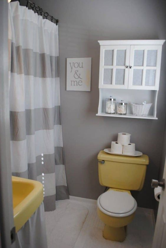 toilet with yellow bowl, white seat, yellow cistern on the bacl