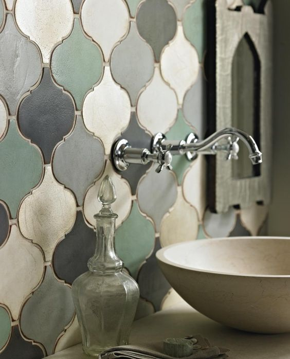 vanity with white marble, white concrete sink, arabesque tiels on green scheme colors on the wall